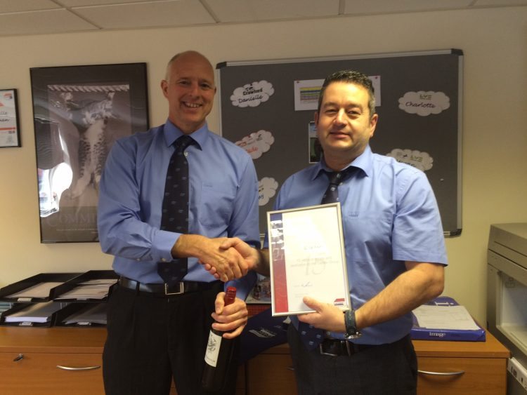Chris Kent receiving his award from Steve Gelder, CEO.