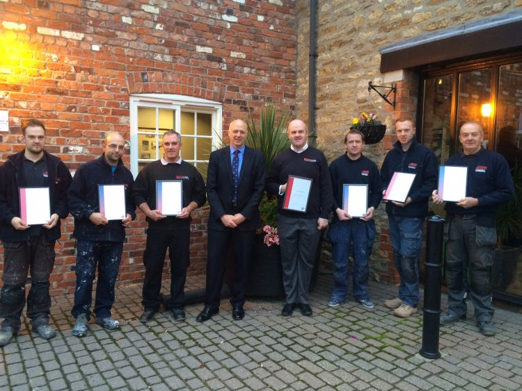Gelder Group Insurance tradesmen receiving their awards.