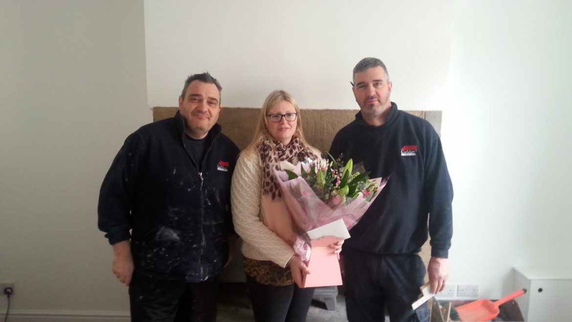 Joanne Wood being presented with flowers from Gelder Tradesman.