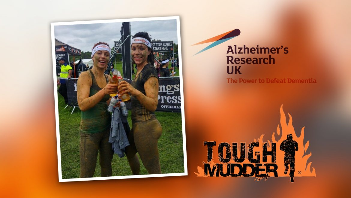 Tori with her sister after successfully completing the Tough Mudder course.