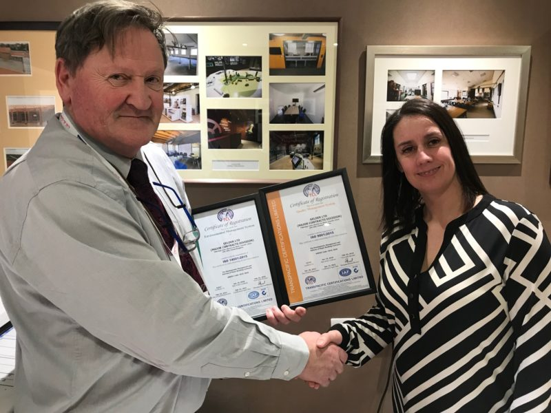 Handover of ISO certificates. Paul Jackson and Stacy Williams.