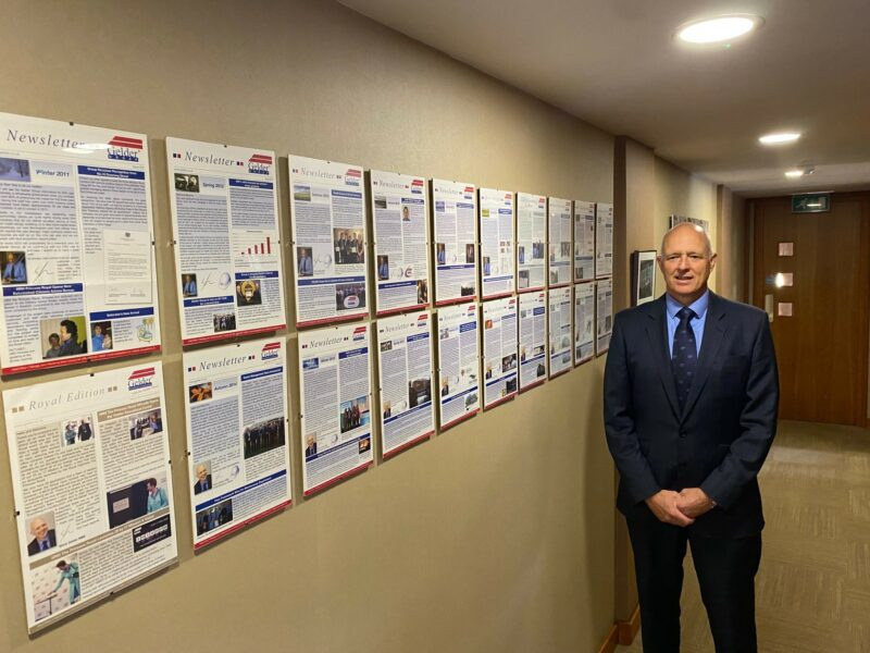 CEO Steve Gelder with collection of published newsletters.